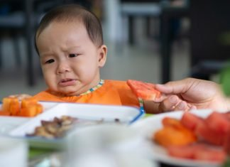 If your baby won't eat solids, try some of these suggestions to help ease the transition.