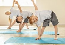 Practicing kid friendly yoga poses is a great way to introduce your child to something new.