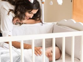 How much weight a crib can hold depends on the weight limits specified on the manual.