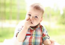 Your baby can be chewing on their hand for a variety of reasons, all of which are completely normal.