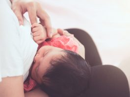 Breastfeeding can be a very comforting experience for newborns which creates a challenge when trying to keep your baby awake in the process!